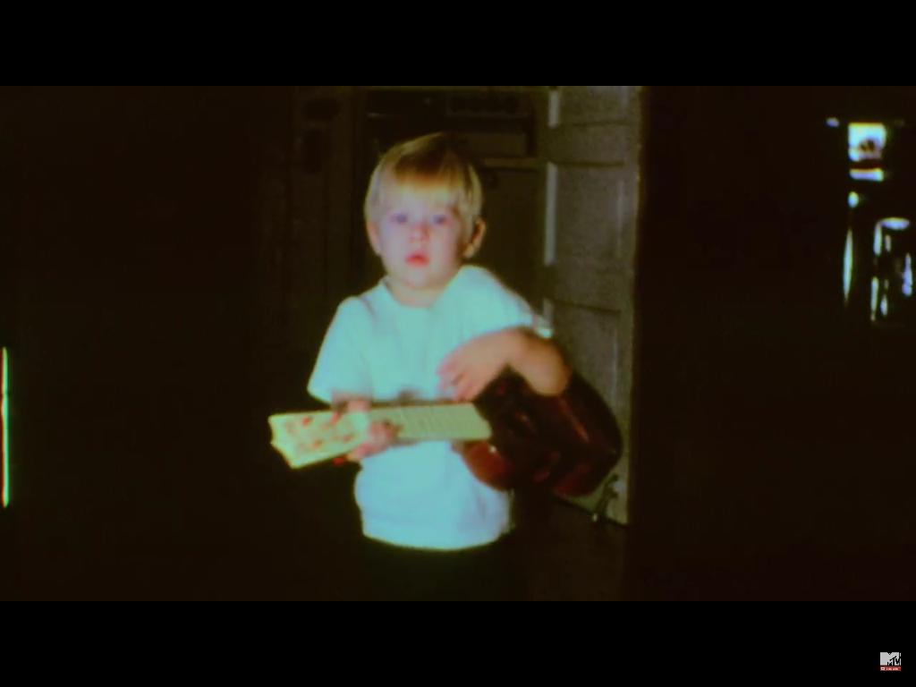 Kurt Cobain playing ukulele as a Child
